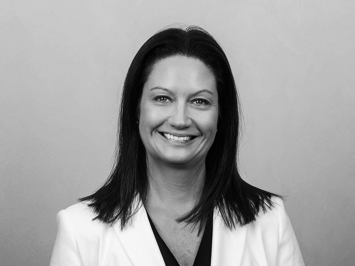 Corporate headshot of a female, in black and white photography.