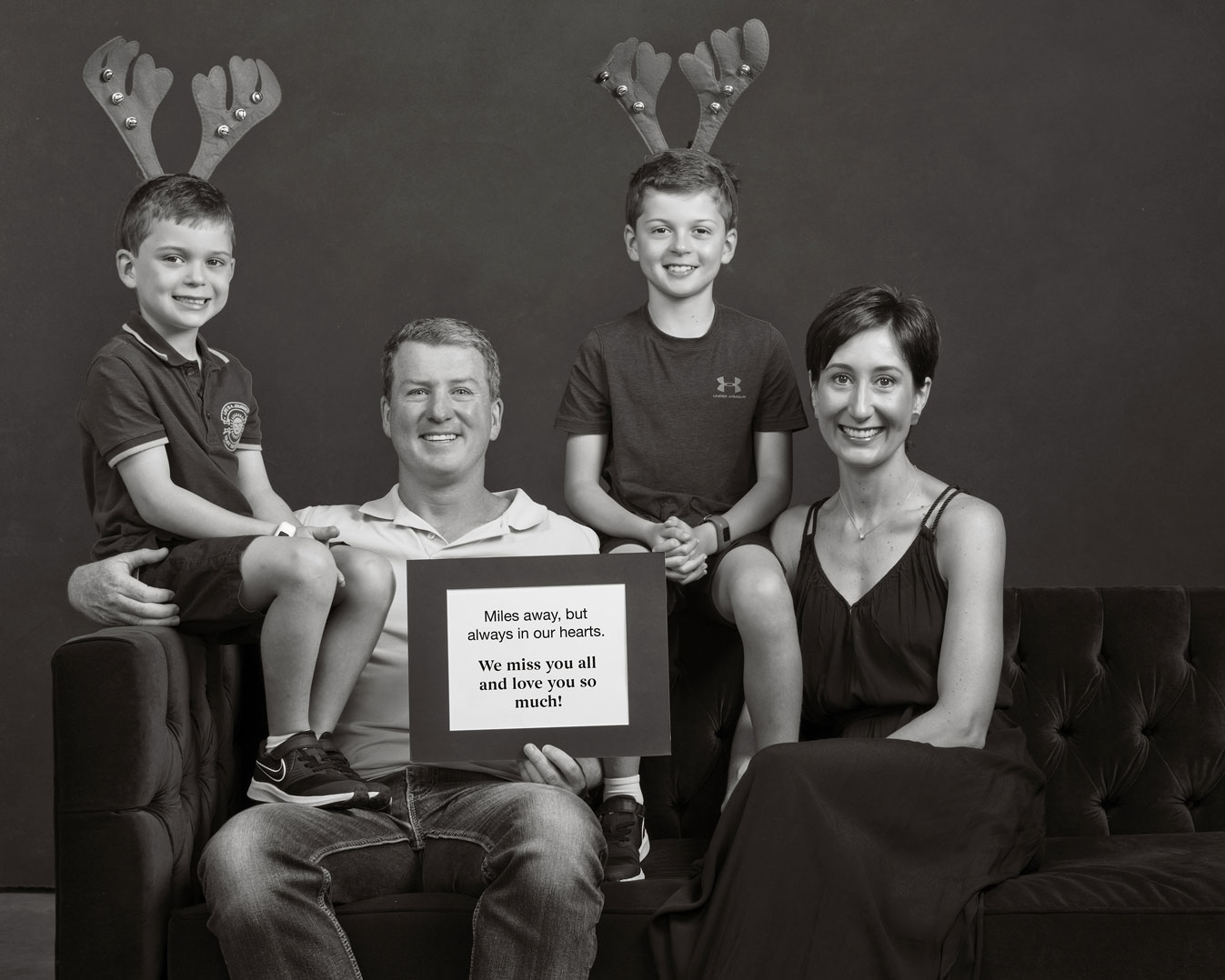 Family of four with a Christmas message for loved ones.