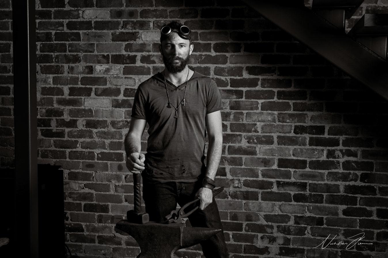 Levi Pendlebury with blacksmithing equipment