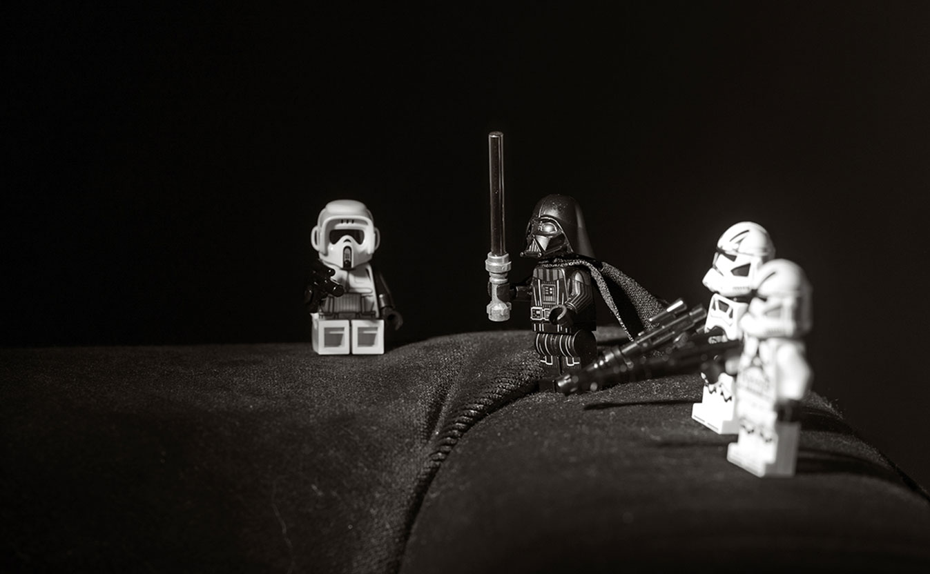 Black and white photo of Star Wars Lego mini figs on couch
